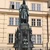 Charles IV, King of Holy Roman Empire.  His statue stands at beginning of Charles bridge.
