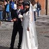 Bride and groom in front of town hall