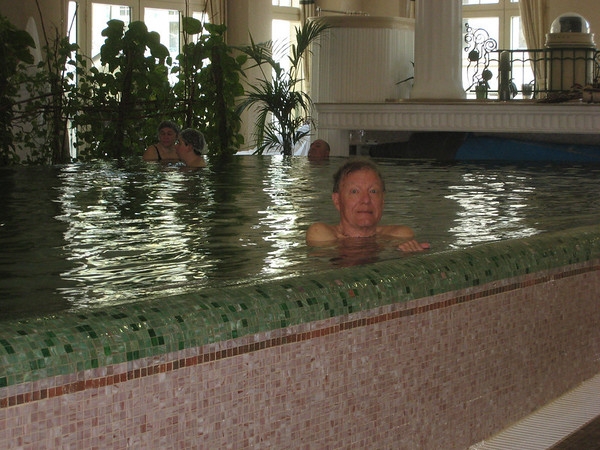 George in warm jacuzzi pool at spa.