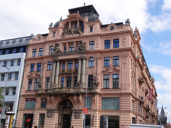 Beautiful architecture of Prague; many houses had painted decorations and sculptures on them.
