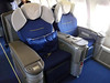 103 first class cabin upper deck (adjoining seat is blocked for all 8 passengers and converts to a flat bed)