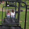 Casey and Jena on the chair lift at Snow King Mountain to get a view of Jackson from above and take a short hike. Mom and dad were on the chair in front and turned around to get this shot.