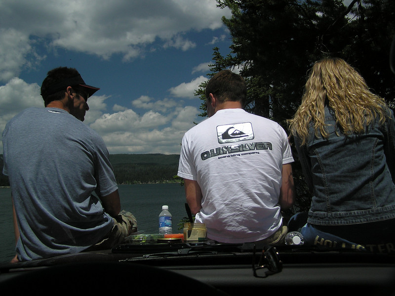 Enjoying lunch while on the hood of the car. Curt, Brett and Casey.