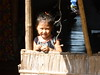 Young girl in Kampong Cham watching tourists