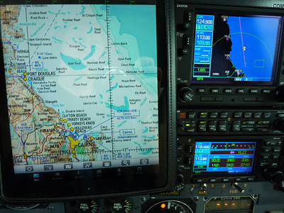 N178SG - flying VFR along the Great Barrier Reef.  In the upper left corner of the Garmin 530 the airport pf Cooktown is indicated, the place where James Cooks landed in 1770, almost ship-wrecked, after his ship had struck the vast reef.