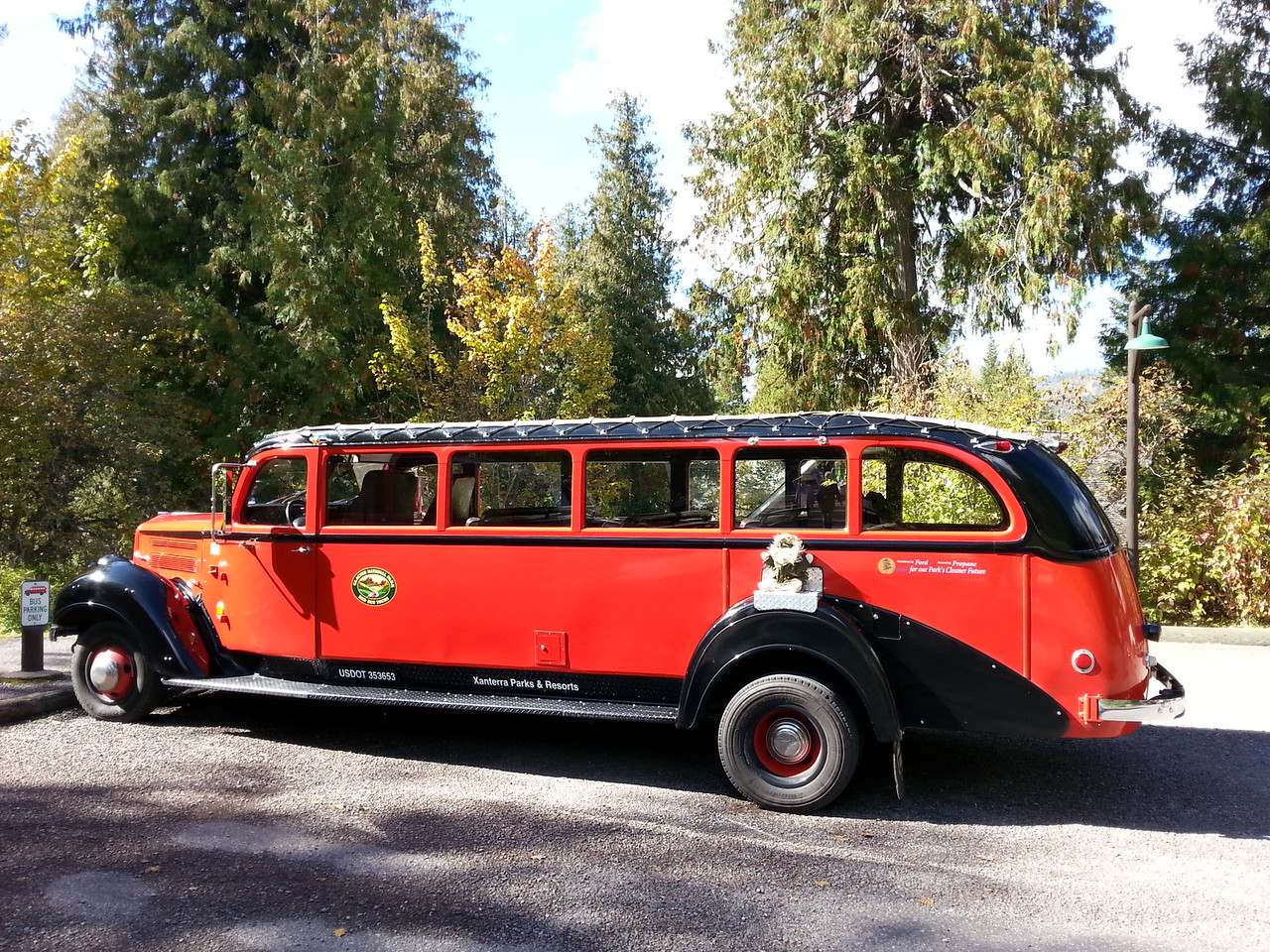Red ' Jammer' tour bus Glacier National Park