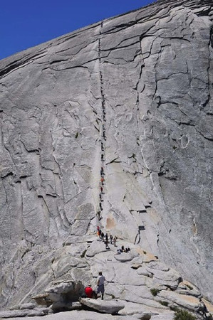 This is a photo from a National Parks Service web site... I didn't take this one!  .. It shows the cables leading up to the top of Half Dome.  You can see where the cables start their 45 degree climb for the last 400 feet.  And this is at the end of a 5,000 foot ascending trail just to get here!