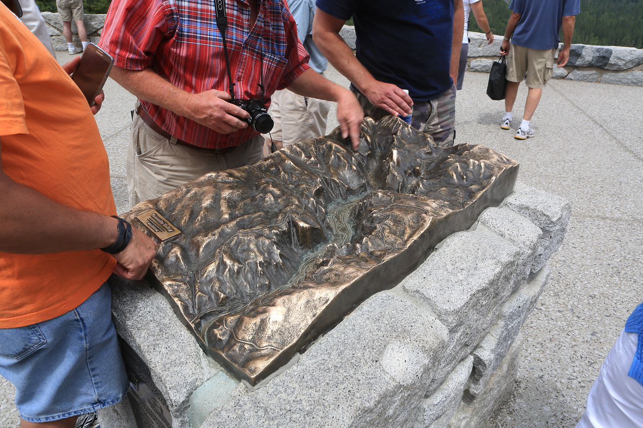 A brass relief of Yosemite Valley mounted at the Tunnel View Overlook.