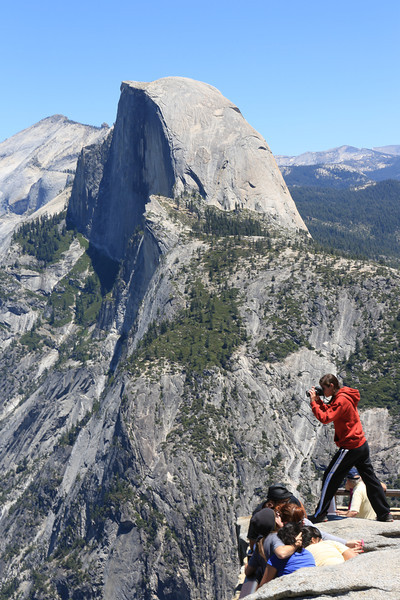 Young girl taking a photo from the top of the wall at Glacier Point. I guess she couldn't get the shot from 5' lower.  There have been two deaths in Yosemite in the first six months of 2013.  Seven died there in 2007 and a record fourteen in 2011.