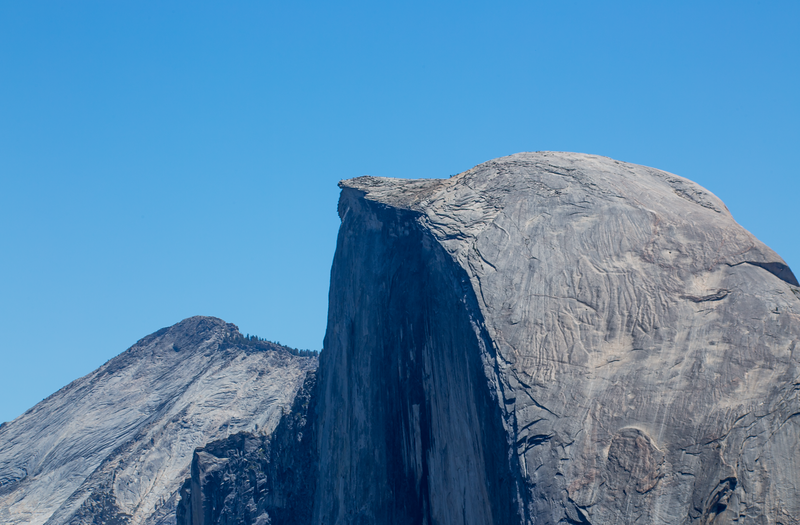 "Image 3 of 5: You can just barely make out a figure on the tip of the Half Dome ledge called the ""Diving Board""..."