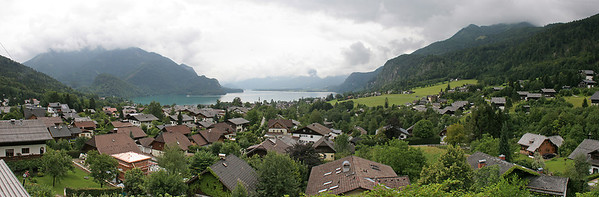 Rain came and went all day during our tour.  This multi-image panorama looks out to the lake called Mondsee.  On the other side of the lake we will visit the church in the town of Mond in which the real Von Trapps were actually married.
