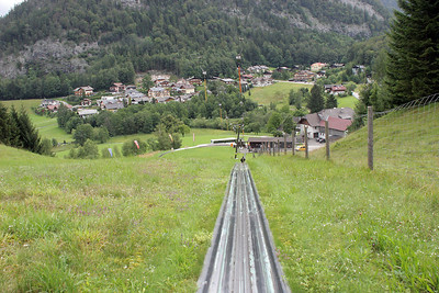Looking down the luge track as I am being hauled up, backwards, to the top.