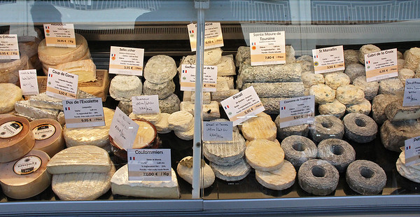 "Marché des Capucins : From Wikipedia : ""Traditionally, there are from 350 to 400 distinct types of French cheese grouped into eight categories : 'les huit familles de fromage'.  There can be many varieties within each type of cheese, leading some to claim closer to 1,000 different types of French cheese."""