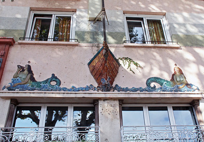 A hotel/bar along the waterfront has this lovely 3-D mermaid theme above its front windows.