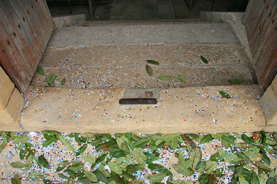 The doorway into the church, littered with the remains of some celebration.