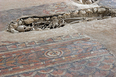 Burials in later centuries dug through the floors of the old Roman villa which by then was well covered by dirt.