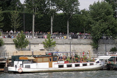 The Tour de France goes by on the roads above as we float along the Seine (really!).