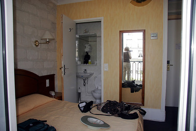 Our hotel room; the bathroom was so small one couldn't close the door while sitting down.