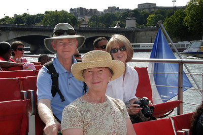We take the traditional ride down the Seine on the Bateau Mouche.
