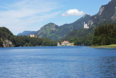 Looking back from the end of the Alpensee, toward Hohenschwangau.  The castle of Hohenscwhangau is up on the hill at the left, and the castle of Neuschwanstein is up on the mountain to the right.
