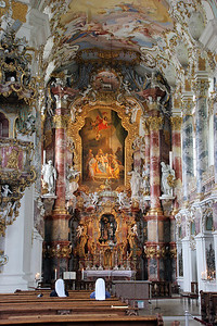 Weiskirche's Rococo altar.  Note the two nuns sitting in the pews.