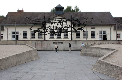 """A memorial constructed in front of the old camp administration building.  """"Only"""" 32,000 inmates died at Dauchau, relatively few when compared to one million deaths at Auschwitz in Poland.  However, Dachau was notorious as the first camp and as a training camp for the guards and administrators for other camps.  Also, eventually many Dachau prisoners were shipped east to Auschwitz and other camps for extermination."""