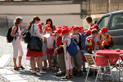"""Red Hat Society""?   Well, another group of school kids on an outing, this time waiting to see St. Peter's Church."