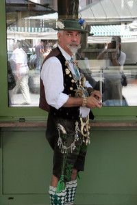 We went back to the Viktualienmarkt looking for lunch, where we found this guy in full Bavarian attire.