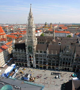 "The view from the top of St. Peter's bell tower down over Marienplatz and the elaborate ""new"" City Hall building.  This is 5 horizontal images stacked vertically and stitched into a panorama (hence the curvature on the city hall building)."