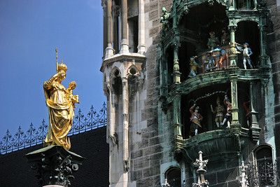 On the left, the golden statue of the Virgin Mary, the namesake of Marienplatz.  On the right, you can see the figures in the glockenspiel in the new City Hall tower.