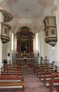 The modest interior of St. Bartholomew's Church.  Reminded me just a bit of the inside of a Spanish mission in California; different decor, but a similar feeling.