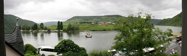A multi-image panorama of the view from our hotel window in Beilstein on the Mosel River.  The boat in the center is a small ferry crossing the river.