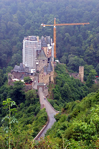 Burg Eltz, undergoing economic stimulus restoration.   It was a long 1/2 mile, very steep walk down a road to the castle.