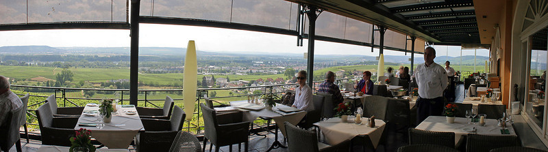 A multi-image panorama from the dining patio of the Johannisberg Castle restaurant with its view over the Rhine River valley.