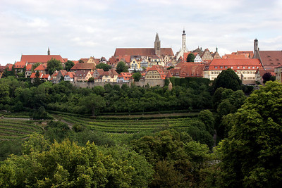A view from one part of the city wall across a small valley to another part of the town.  The high, white, single tower is the city hall on the Market Square.