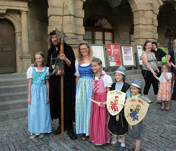 Medieval enthusiasts posing with the NIght Watchman.