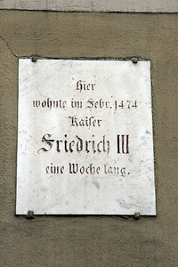 "This house was marked with the German equivalent of ""George Washington slept here.""  This sign says ""Here lived in February 1474 Kaiser Friedrich II for one week.""   His visit would have been a great honor for the town."