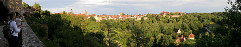 The view from one part of Rothenburg's surrounding wall across a valley to another part of town behind its own part of the same wall.  10-image panorama.