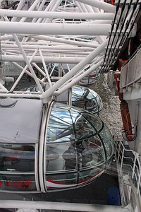 The London Eye has  32 sealed and air-conditioned, ovoidal passenger capsules.  Each capsule can hold up to 25 people.