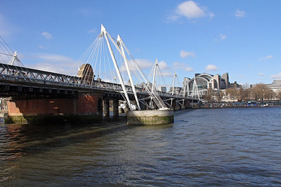 Looking back across the Golden Jubilee Bridge, with Charing Cross Station being the large building at the far end.