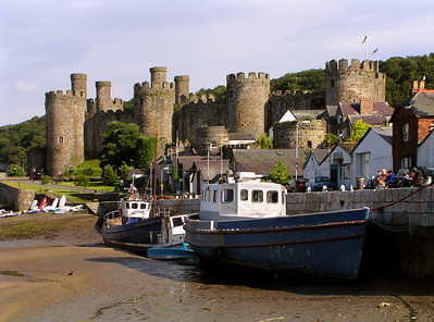 Low tide in Conwy harbor with Conwy Castle in the background.