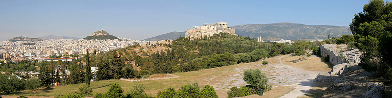 6-image panorama from Filopappou Hill.  The field at right is where citizens gathered  and debated during the earliest stages of ancient Greek democracy.