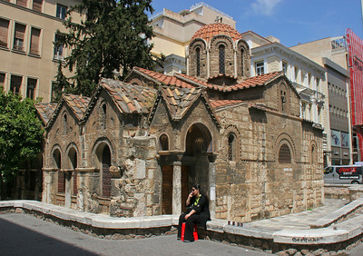 Kapnikarea is an 11th century Byzantine church halfway between the Parliament on Sytagma Square and Monastiraki Plaza.  It sits in the middle of a very busy street, surrounded by modern office buildings.