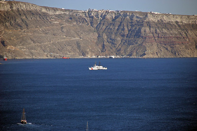Well, this old Coastie was amazed!  There in the middle of the caldera was a 378-foot U. S. Coast Guard cutter!   What a great liberty port!  Behind it you see the ferry terminal where we will dock, and the long road zigzaging up the cliff from the terminal.
