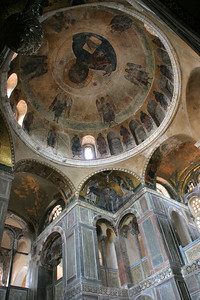 The dome was painted in the 16th century with a mural of Christ surrounded by saints and angels, replacing fallen mosaics.