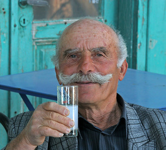 He drinks to our health.  Ouzo at 11am!  Ouzo is clear until it mixes with ice and water when it turns cloudy.