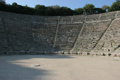 The theater of Epidaurus was built in the 4th century BC.  It is famous for its nearly perfect acoustics.  If you stand on the little stone circle and clap your hands, the echo back to you is quite amazing.  Talk in a normal tone of voice and you can be heard throughout the theater.