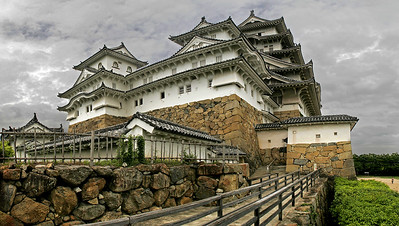 Four vertical images stitched side by side to get a wide angled view of the main tower of Himeji Castle.