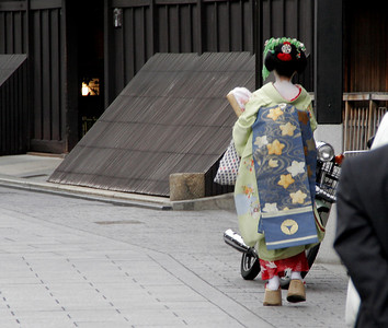 A view from behind as she continues on her way to her evening work at a local Geisha house.