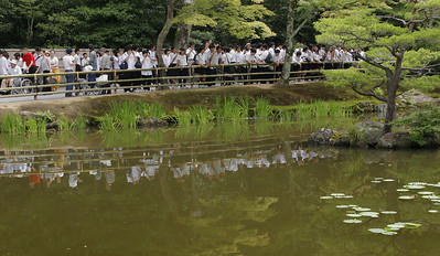 Tours of school children are everywhere in Japan.  This group observes the Golden Pavilion across the water.